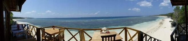 A panoramic view of both beaches at Bara from Cosmos Bungalow's communal terrace